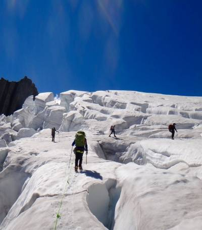 crossing crevasses on glacier
